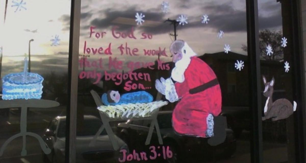 Santa Bowing to Baby Jesus