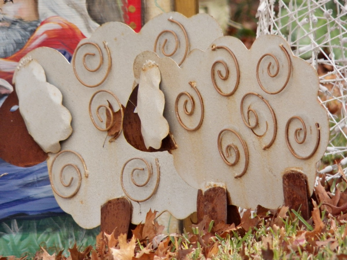 These wooden sheep are displayed around the panel and give it dimension.  A very clever idea!