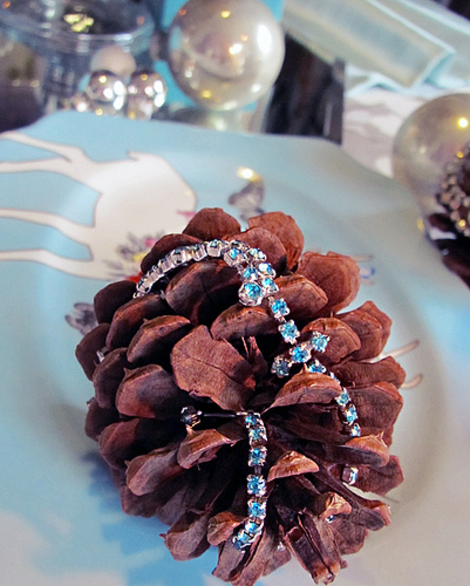 Rhinestones are a simple way to dress up a pine cone for any holiday table.
