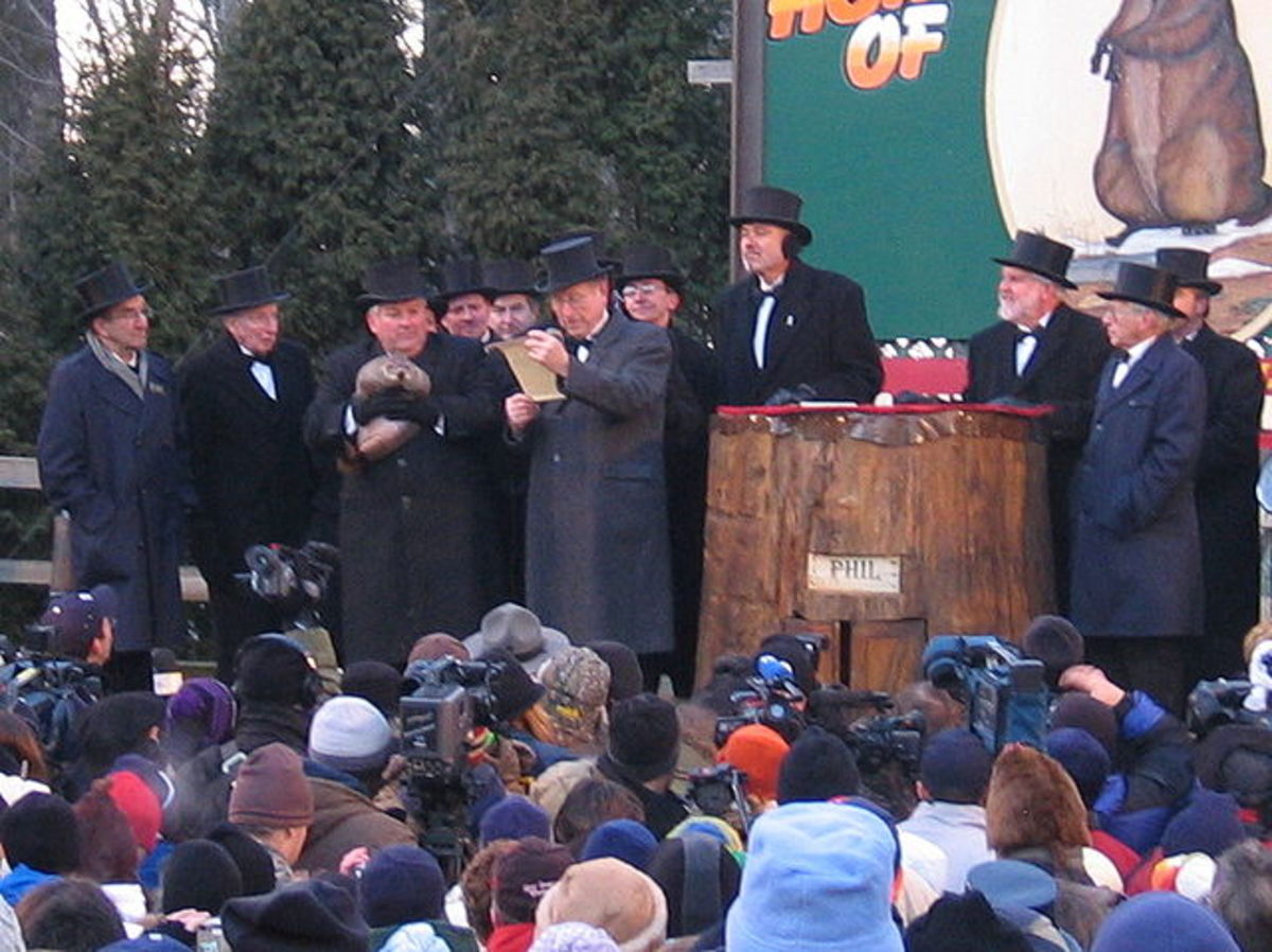 This photo, 2005, shows the annual ceremony, with men in traditional German formal attire, one of them holding Punxsutawney Phil, the famous groundhog.