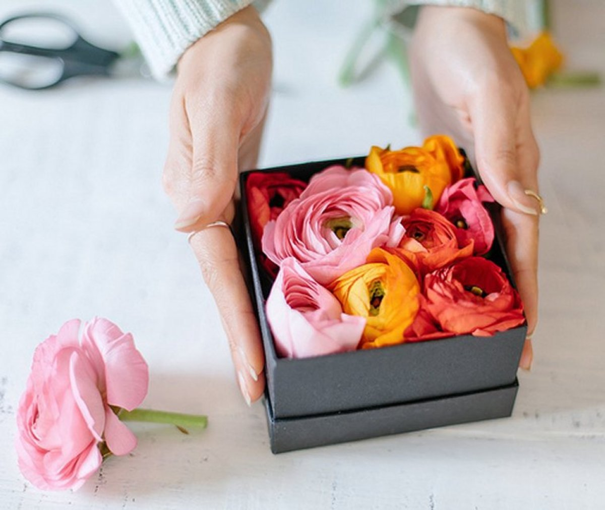 This nice twist to a Mother's Day bouquet is cheaper and you can make it yourself.