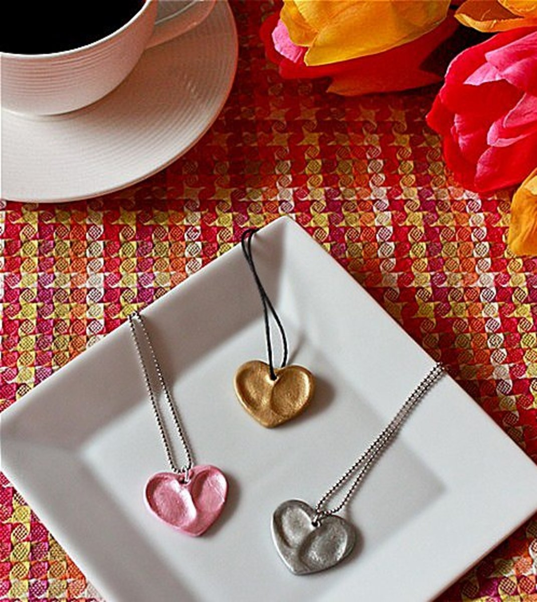 Double fingerprint heart necklaces.