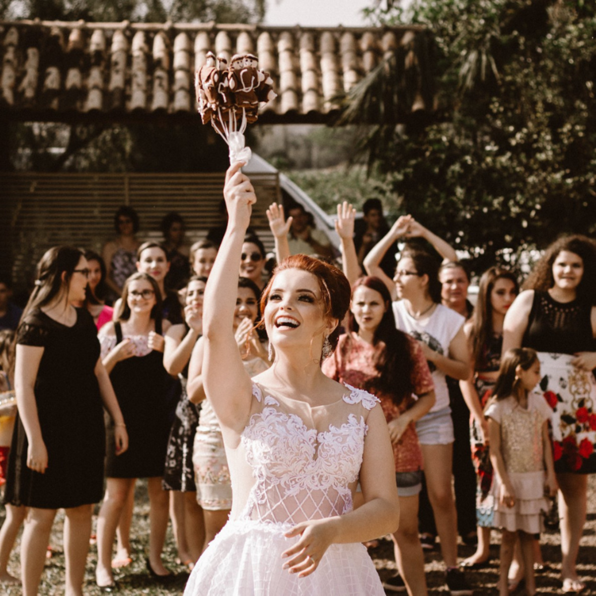 The throwing of the bride's bouquet is a longstanding wedding tradition that is still practiced by many.