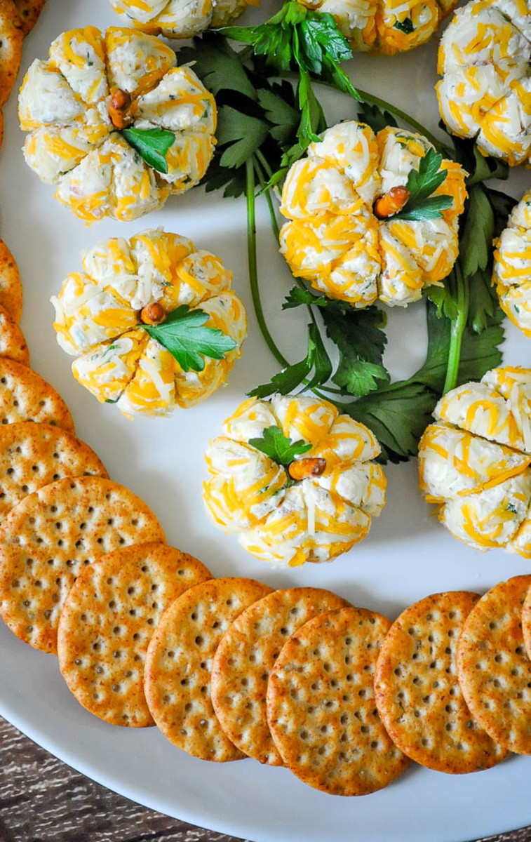 Set the scene this Halloween with these adorable pumpkin-shaped cheese balls.