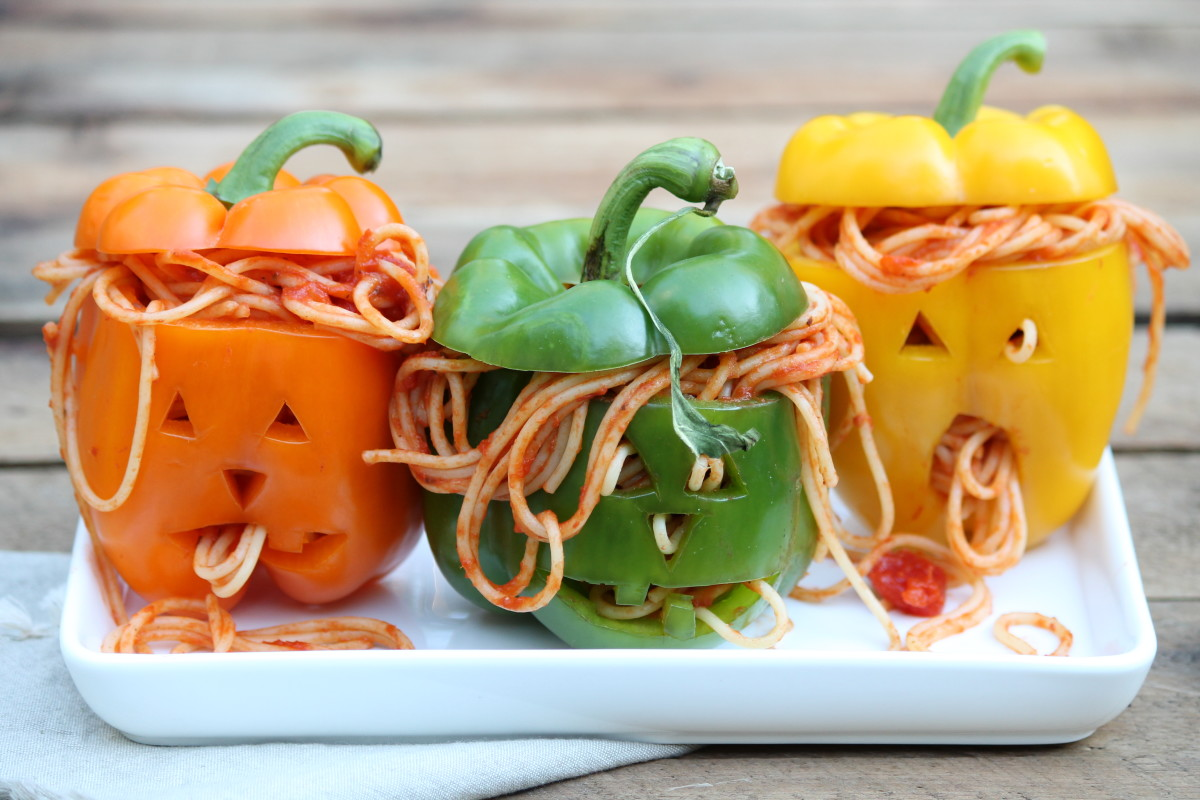 Scare your way into the hearts of friends and family by surprising them with stuffed Jack-o-Lantern peppers.