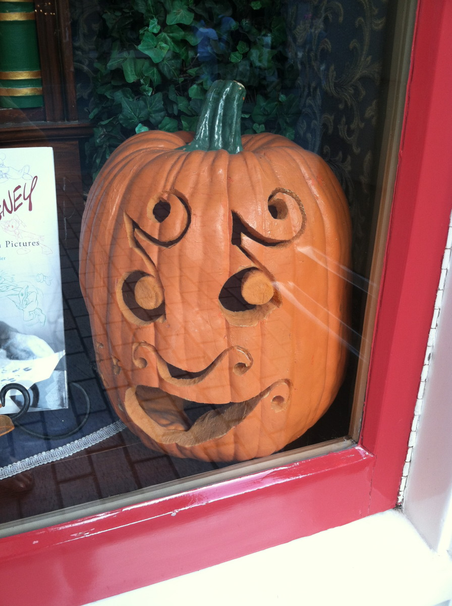 This jack-o-lantern peeks from a window.