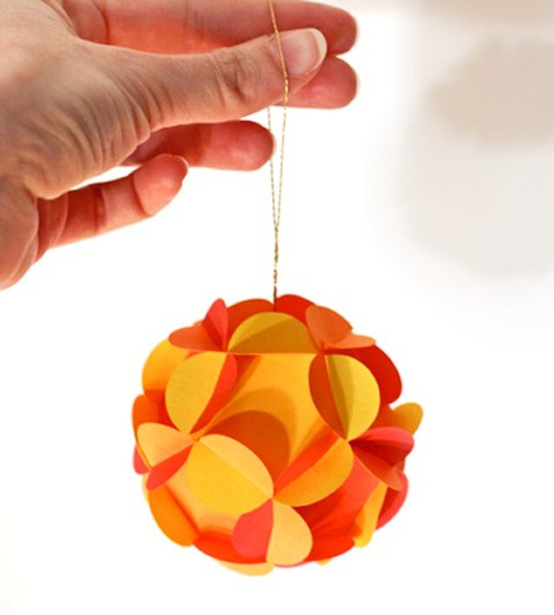 Bring holiday cheer to any room by turning paper into fancy ornaments – no glue required.