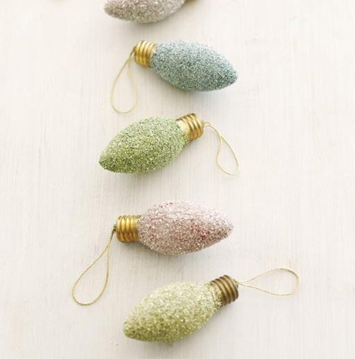 Don't throw away those old lightbulbs. Instead, turn them into pretty Christmas ornaments.