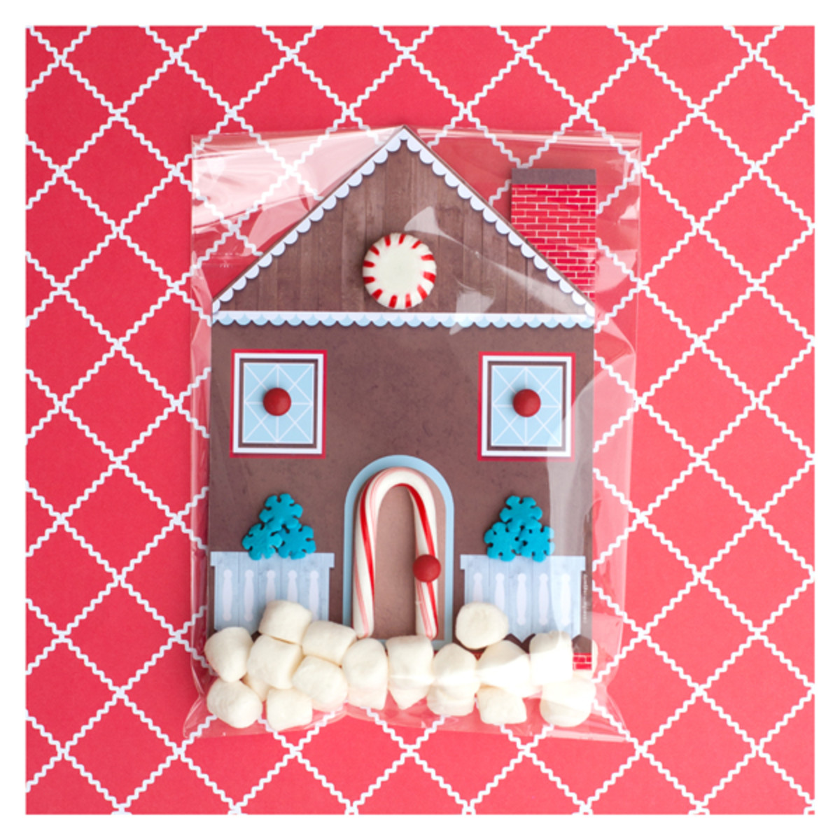 Feel like creating something really cool this Christmas? Try this printable gingerbread house card, decorated with real candy.