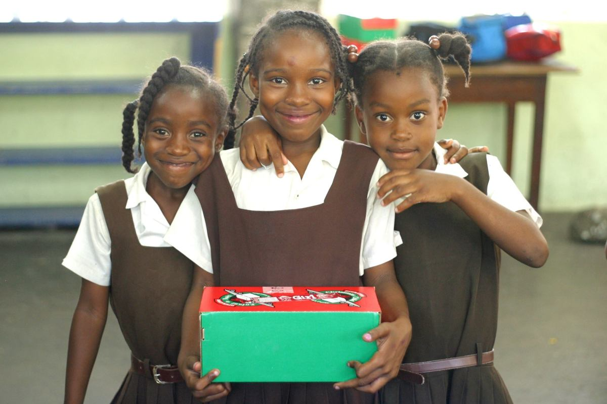 Girls holding a shoebox in St. Vincent.