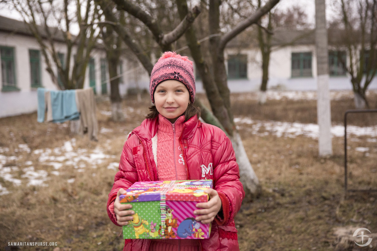 A girl holding her shoebox in Moldova.