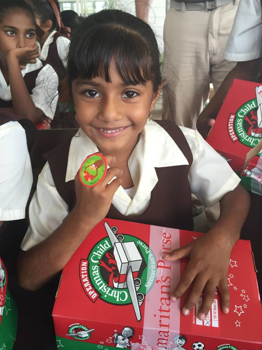 A girl holding her shoebox in Guyana.