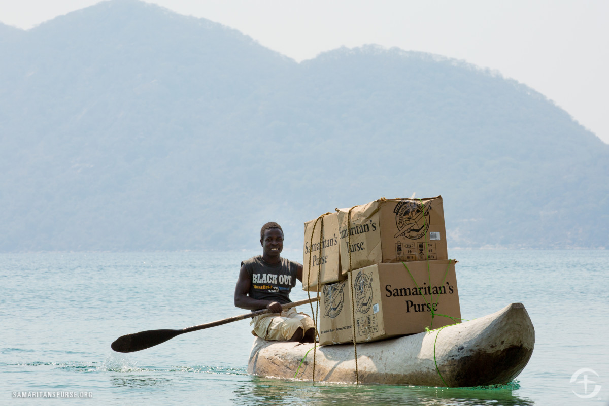 OCC shoeboxes delivered by canoe in Malawi.