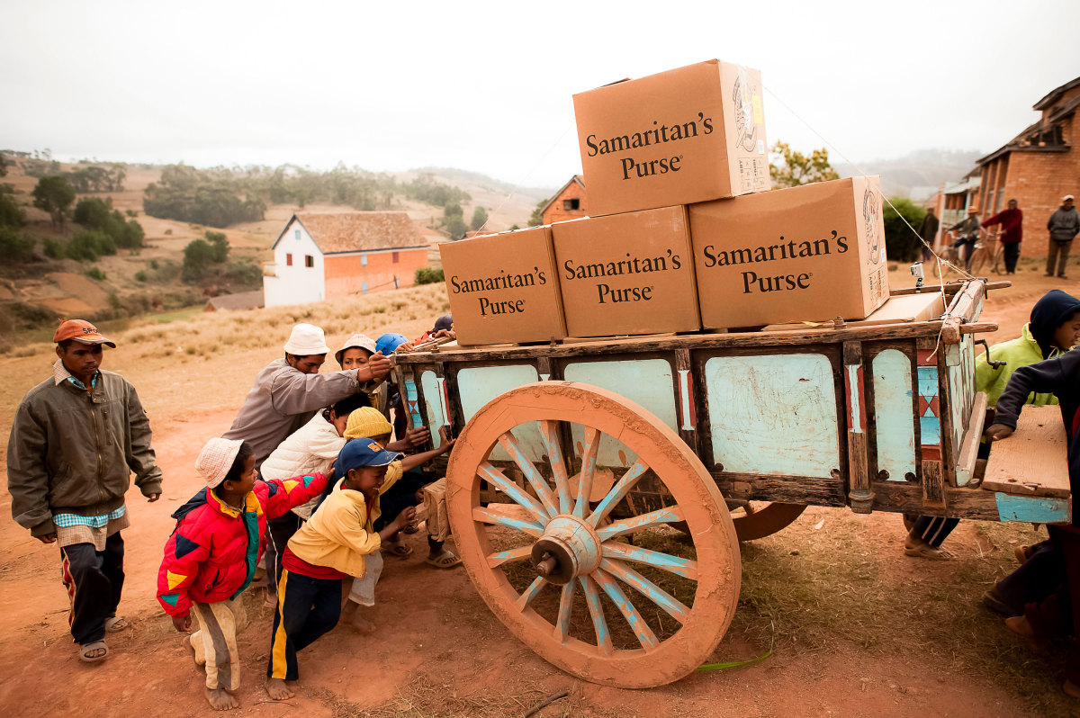 OCC shoeboxes delivered by wagon in Madagascar.