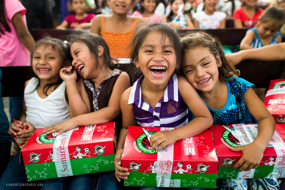 Girl excited to open their shoeboxes in Costa Rica.