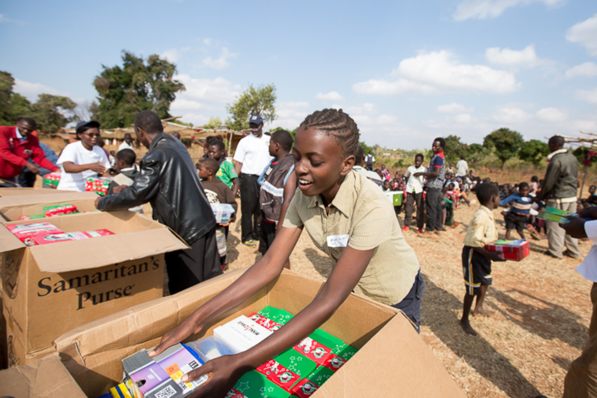 Angella, a 13-year-old girl from Malawi who received a shoebox herself the year before this photo was taken, helps distribute gifts.