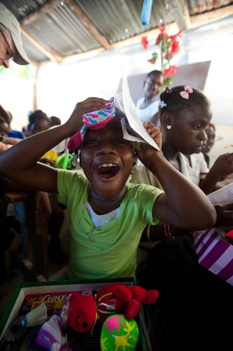 An excited girl celebrating her gifts in Haiti.
