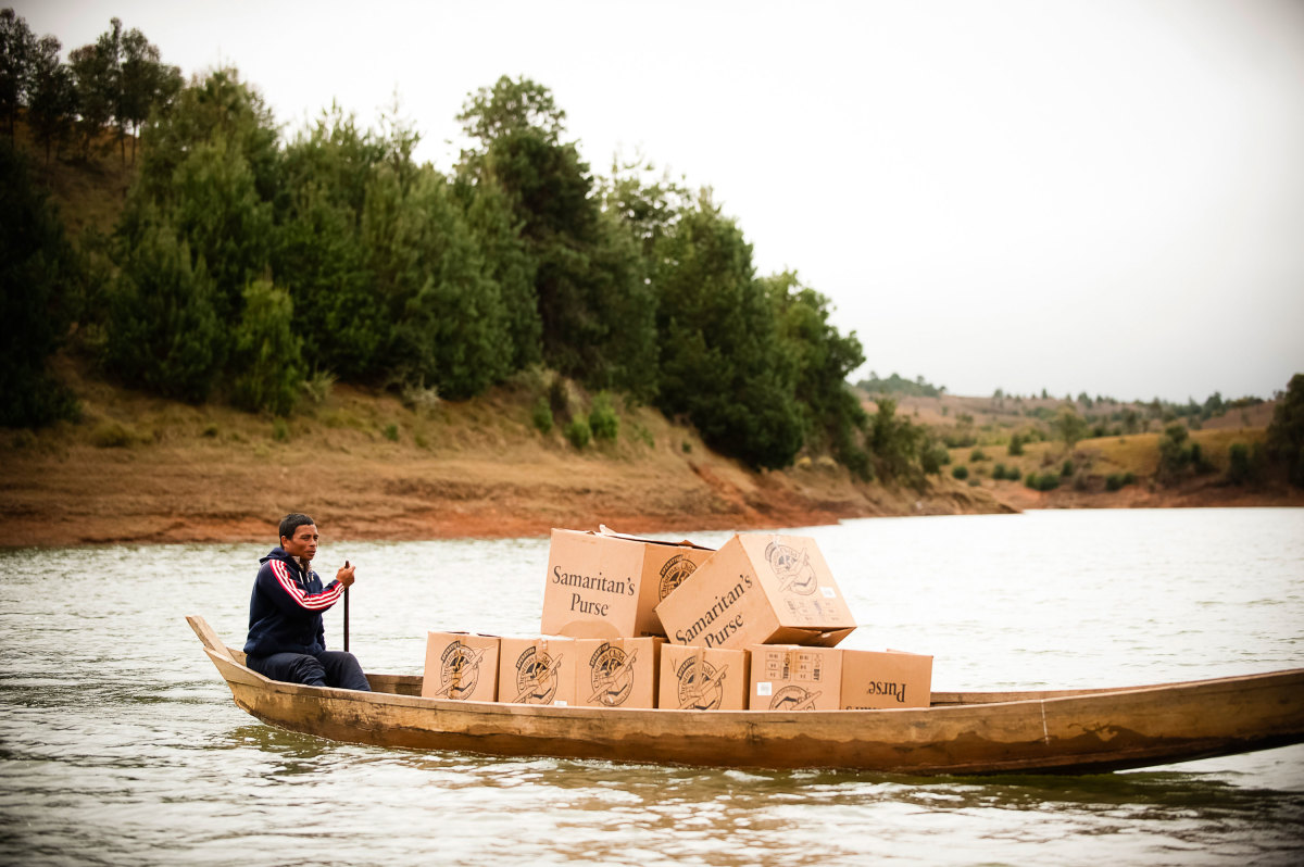 OCC shoeboxes delivered by canoe in Madagascar.