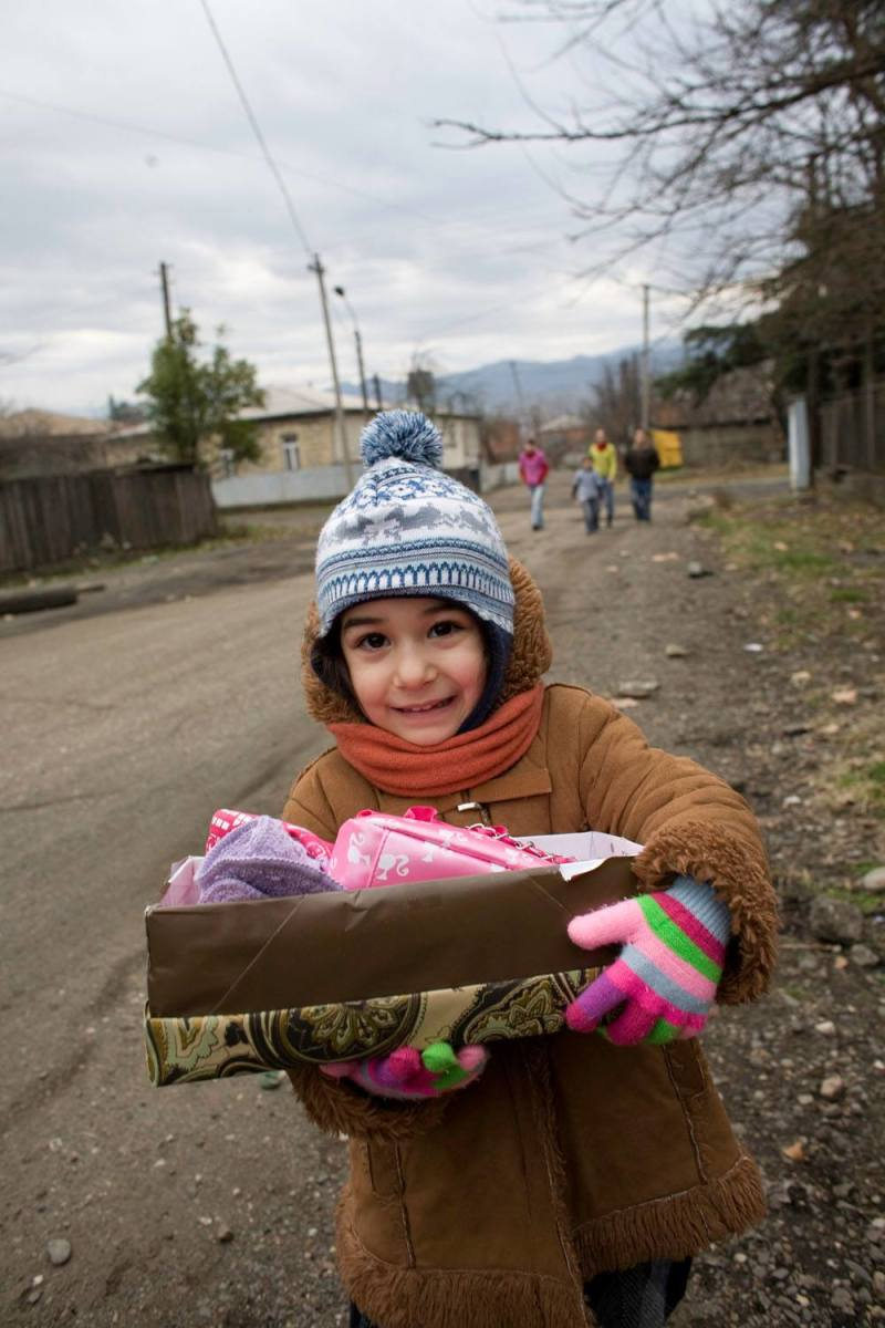 A girl holding her shoebox in Georgia.