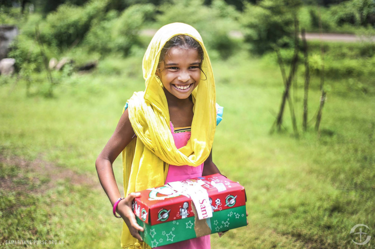 A girl holds her shoebox in Central Asia where access to clean water is limited.