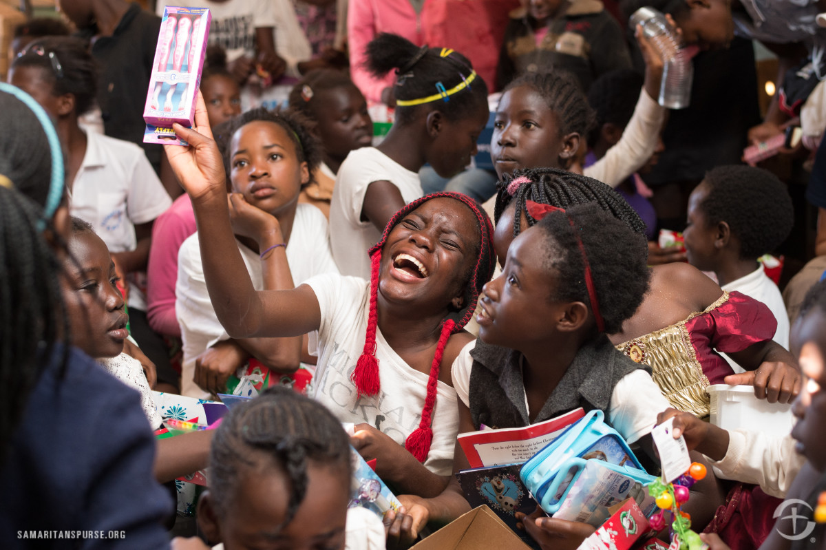 Girls celebrating their shoebox gifts in Zambia.