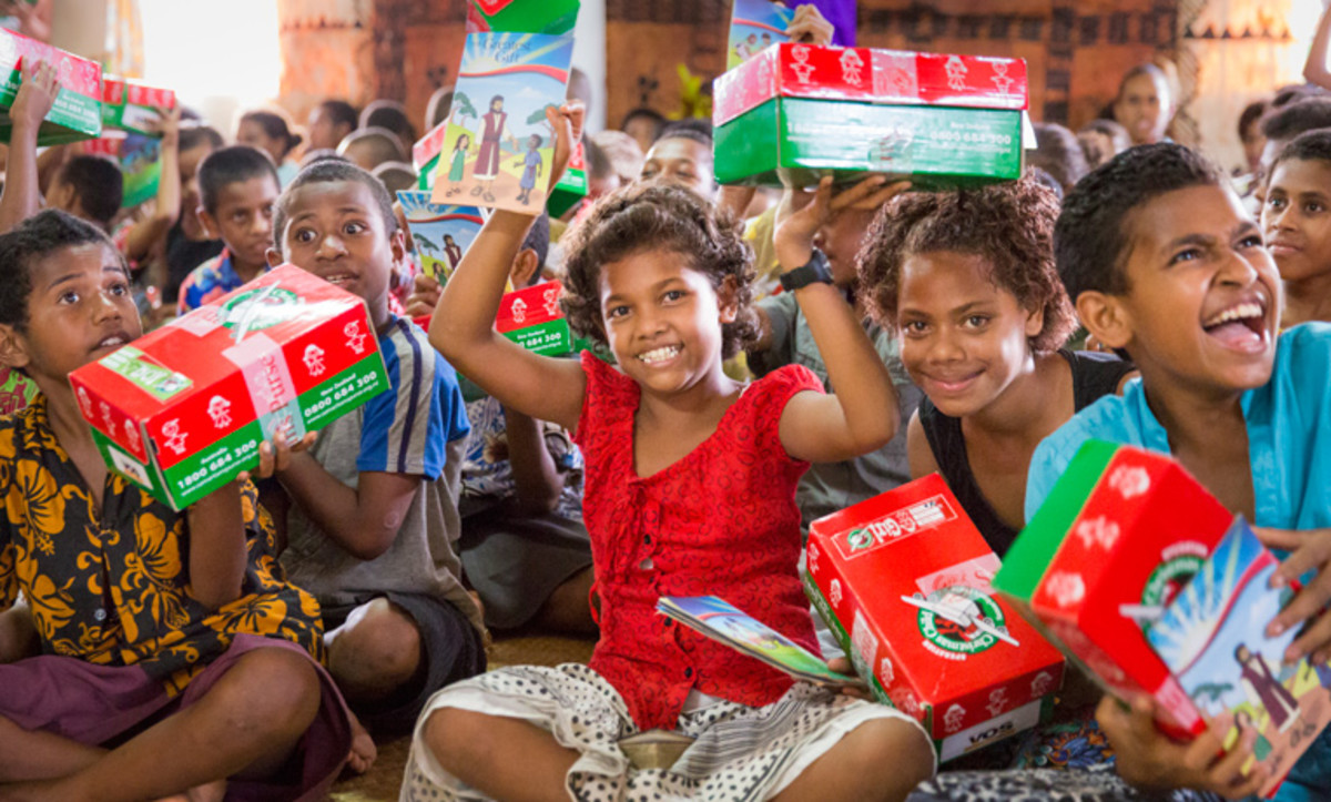 Girls showing off their shoebox gifts in Fiji.