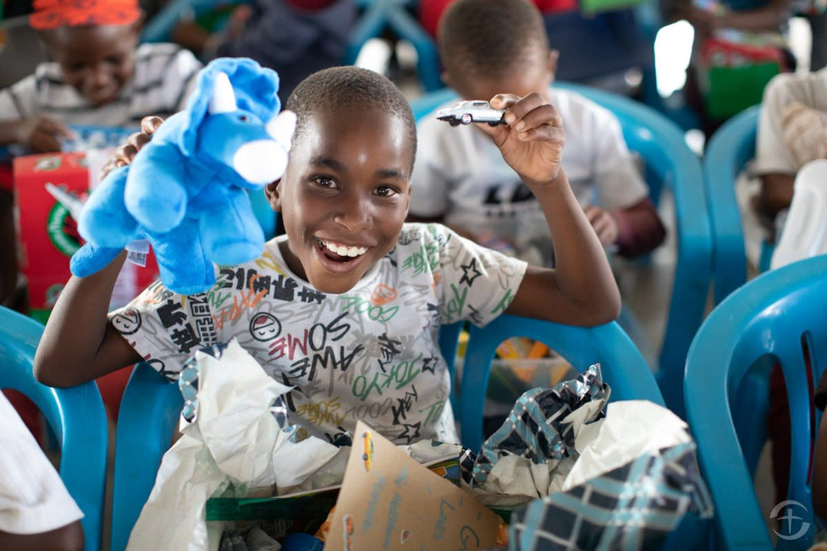 A boy in Botswana proves that a well-made stuffed animal is a guaranteed shoebox hit regardless of age or gender.
