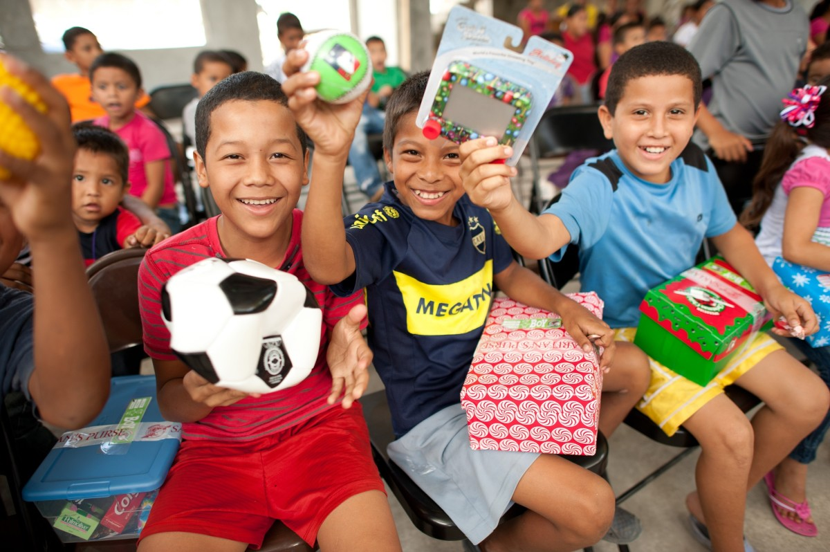 Boys celebrating the toys in their shoeboxes.