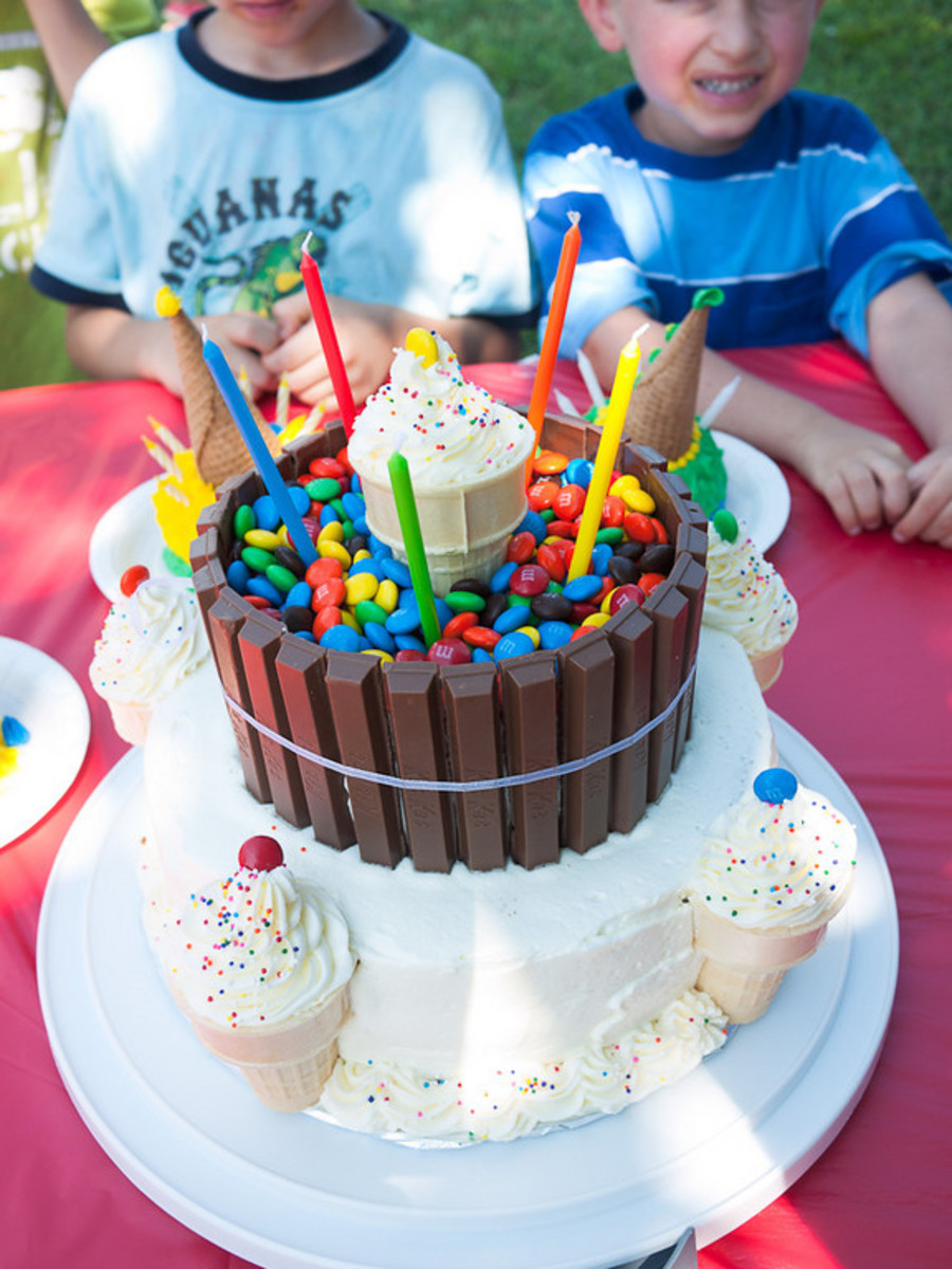 A fun carnival themed cake- complete with candy barrel and icing ice cream cones!