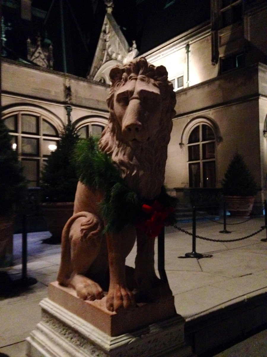Lion statue in front of Biltmore House - all dressed up for the holiday season!