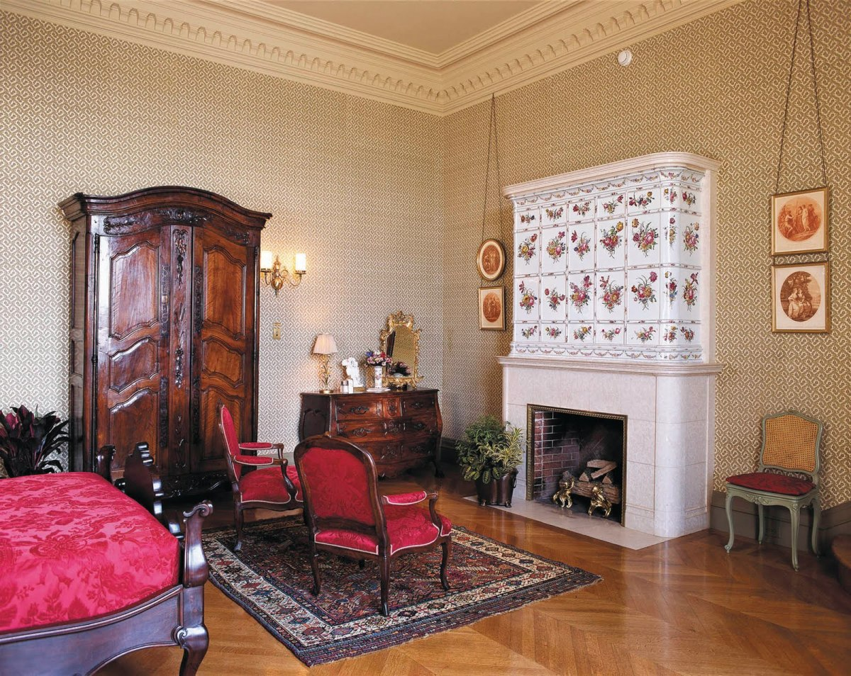 Tyrolean Chimney room - named for the hand-painted 18th Century Swiss porcelain tile overmantel.