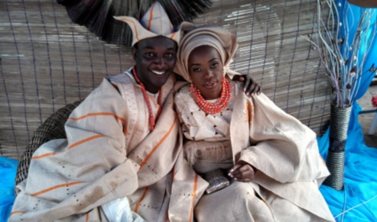 The bride and groom in their traditional attire. The attire depicted here in this traditional wedding picture is the Yoruba Attire.
