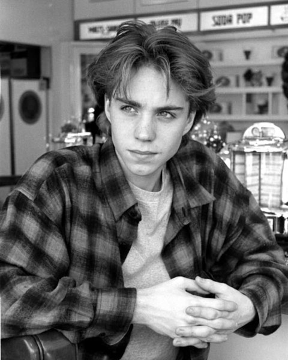 Jonathan Brandis Dec.1993 in Los Angeles, shopping on Ventura Blvd. Flannel shirt, t-shirt, and curtained hair.