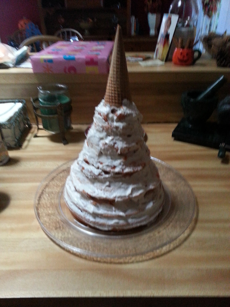 This is my cake after a thin layer of frosting. The waffle cone that serves as the tip has yet to be covered.
