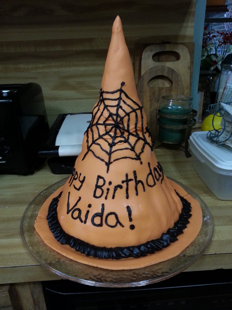 I decorated my witch's hat cake with spider web and spiders.