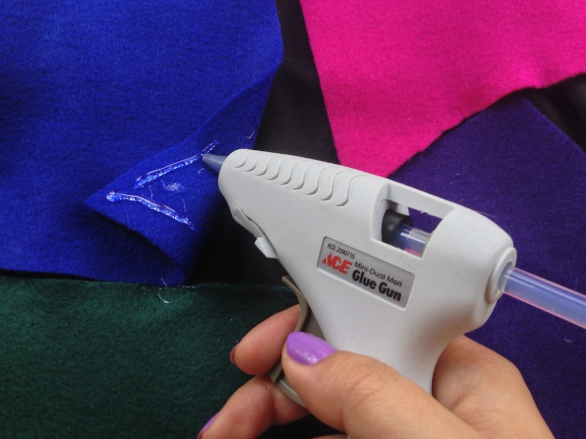 Next, use a glue gun or needle-and-thread to attach the felt to the dress.