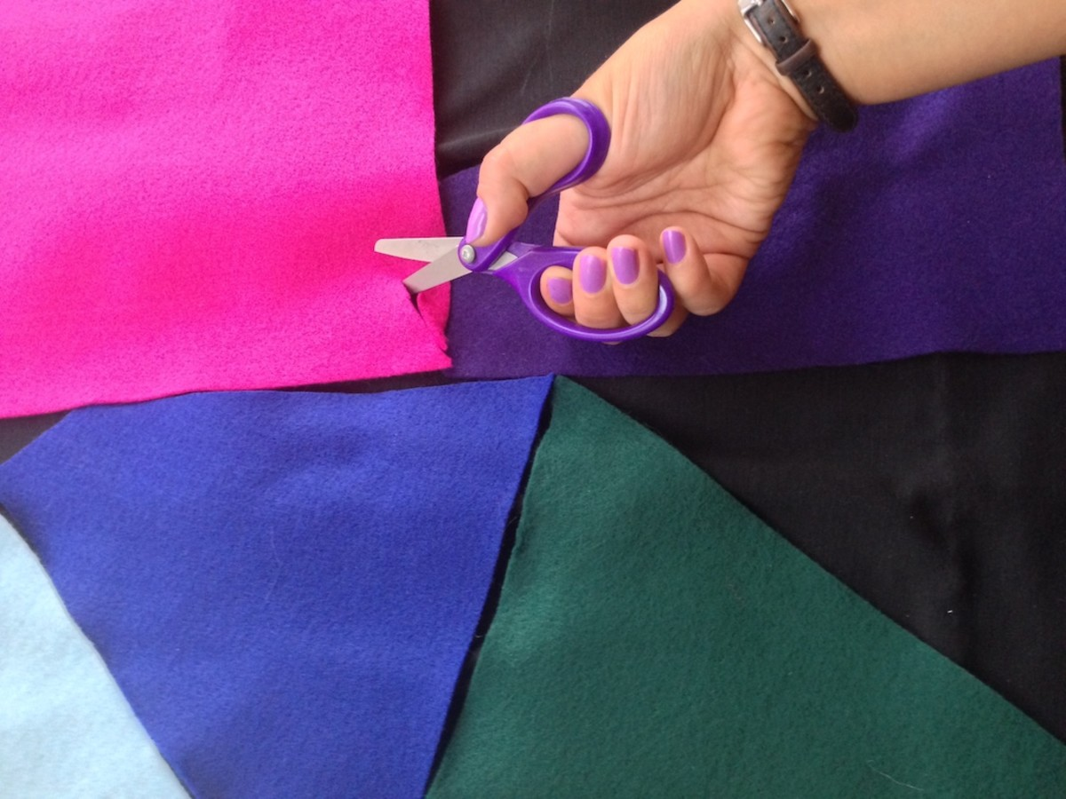 First, cut pieces of felt into the interlocking shapes on Sally Skellington's dress.