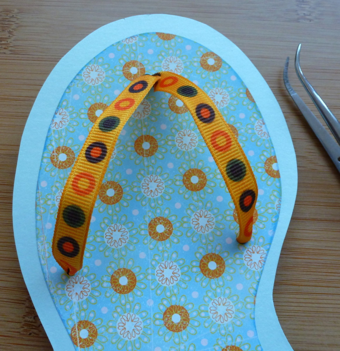Putting the ribbon into the flip flop card summer craft tutorial how to.