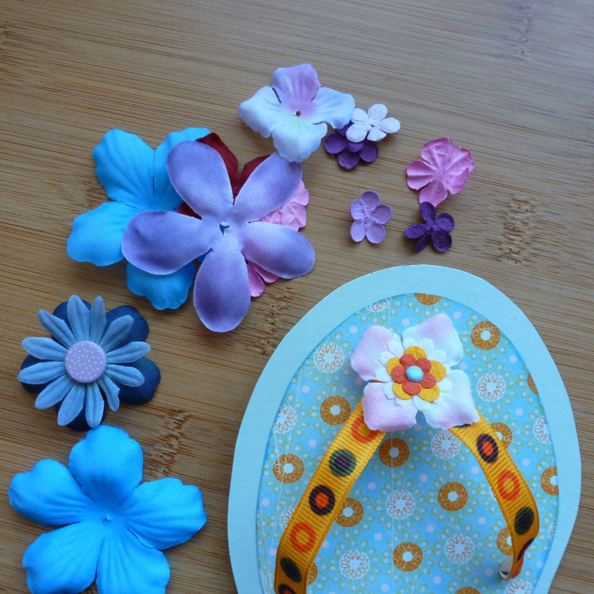 Adding floral embellishments to the shoe card handmade DIY flip flop cards to make.