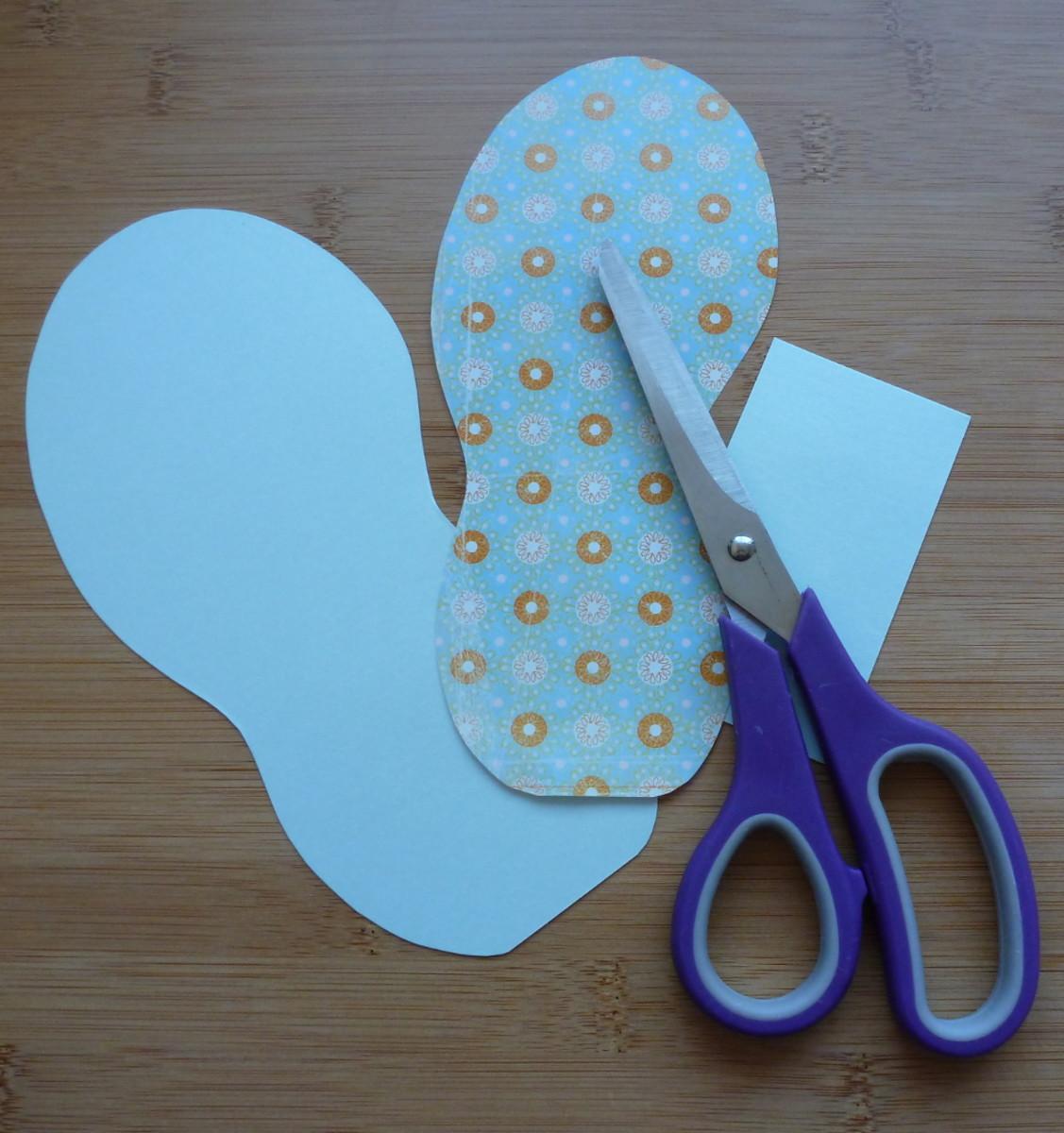 Cutting out flip flop designs.