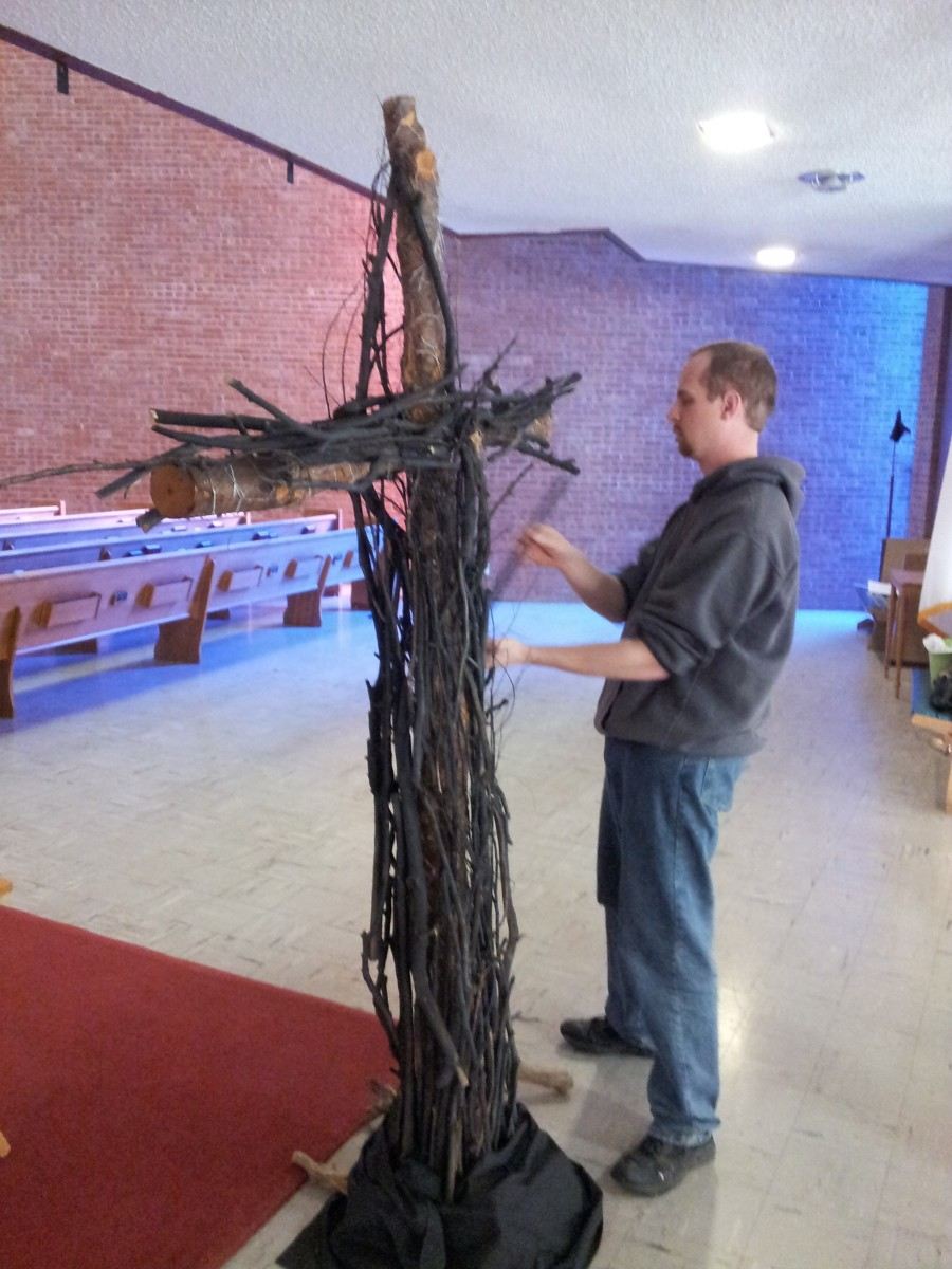 adding sticks to the cross