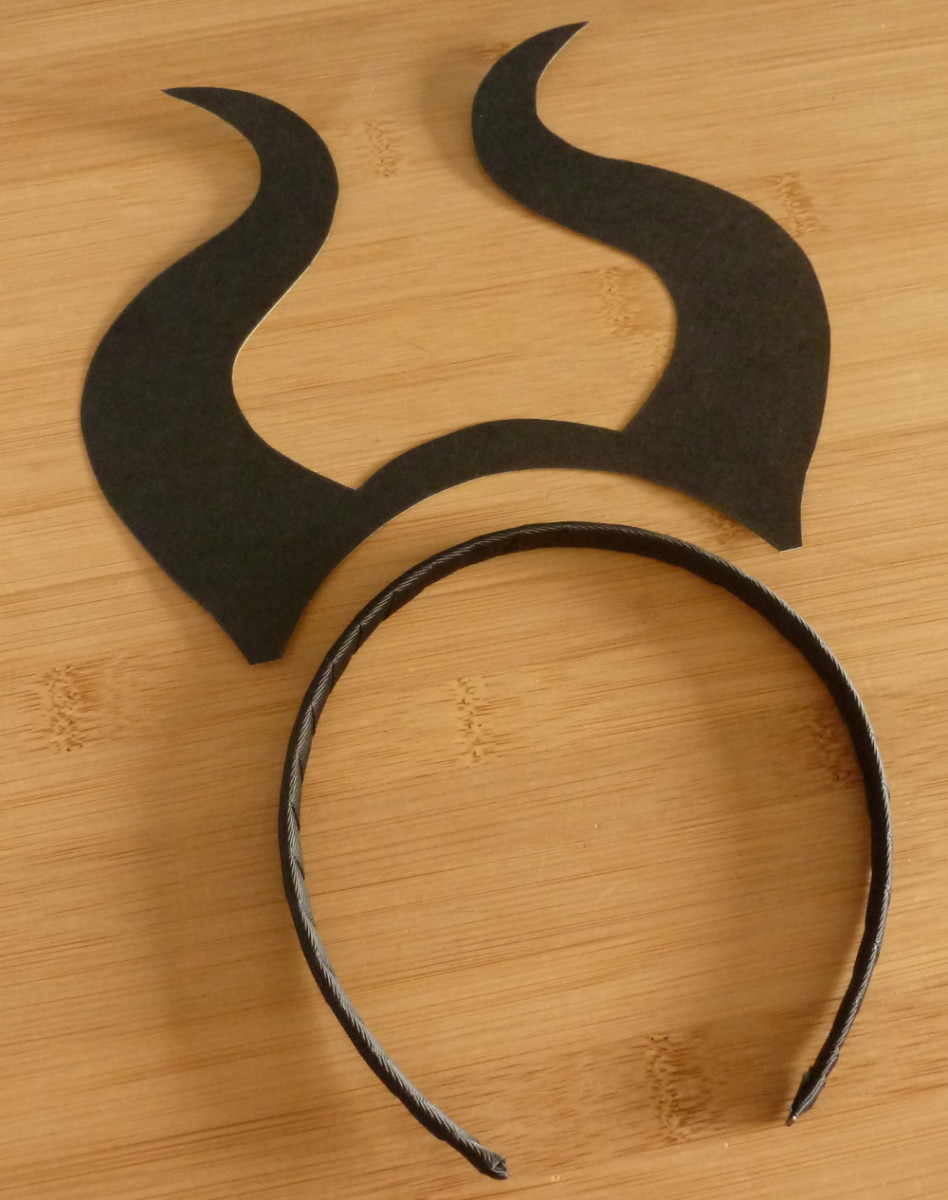 Pieces to make a horn headband with black card and hair band