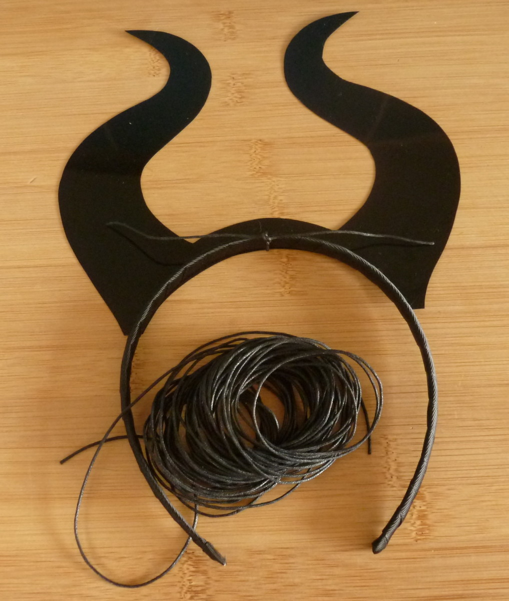 Adding black cord to tie the DIY headband design together