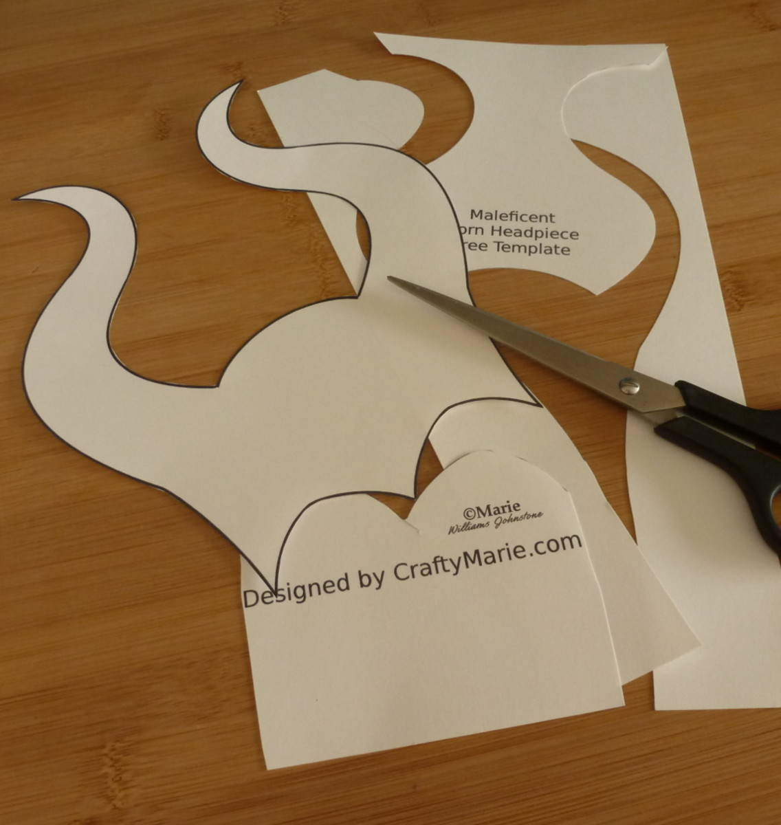 Cutting out the Maleficent paper horns mask