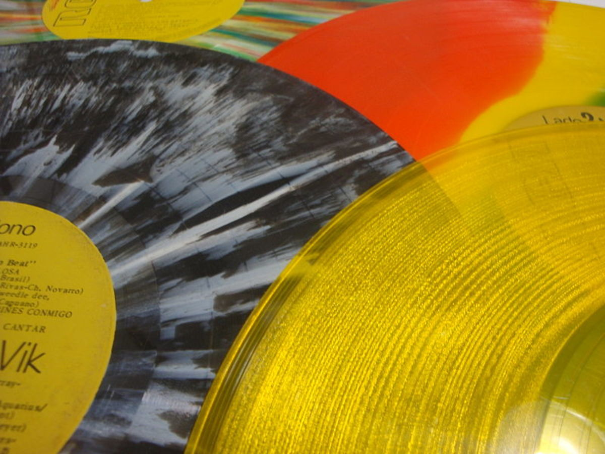 Old vinyl records are perfect vintage decorations...hang them up on the walls or use as table decor.
