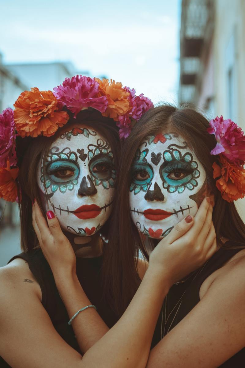 Two women with painted faces.