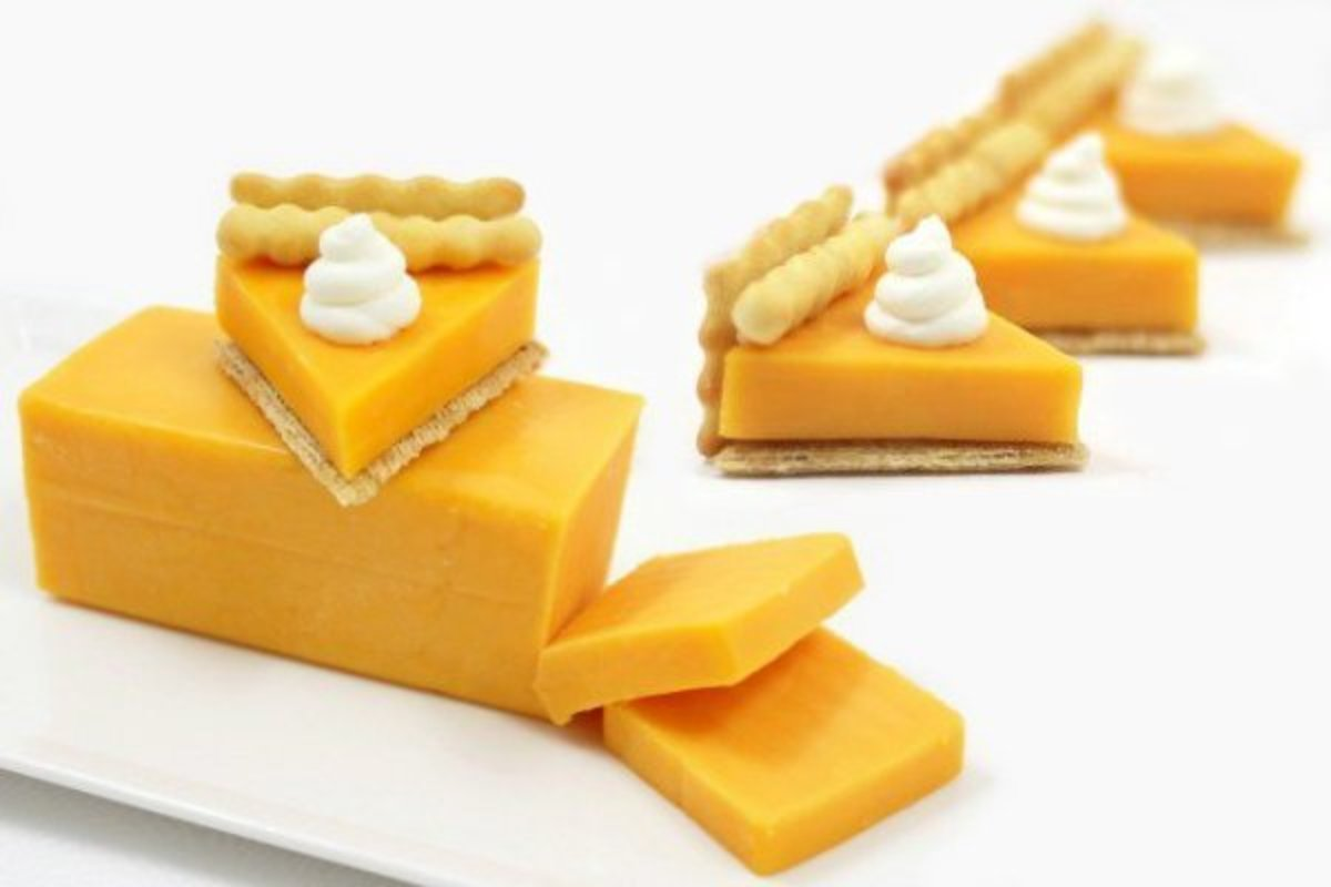 Little pumpkin pie slices made out of cheese and crackers.