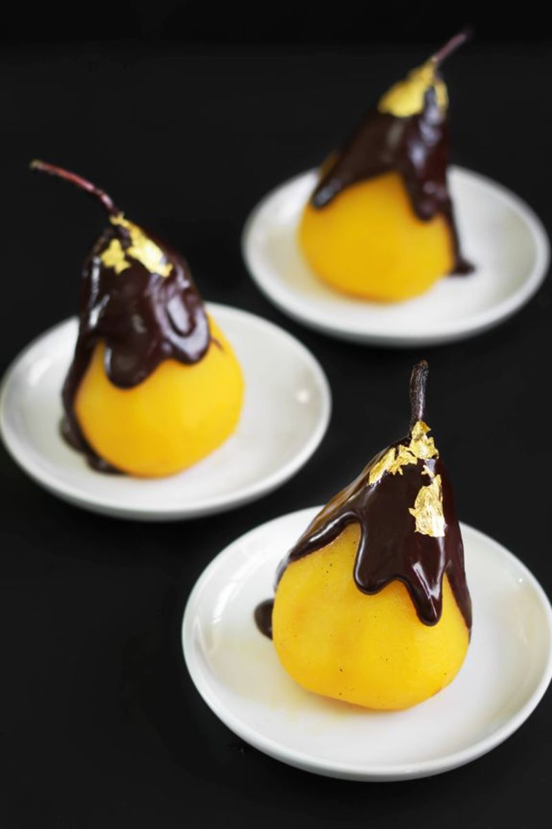 Saffron-poached pears with chocolate are a light and elegant ending to a rich Thanksgiving meal.