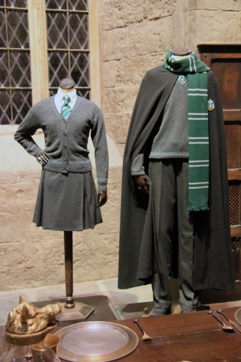 The official male and female Slytherin costumes.