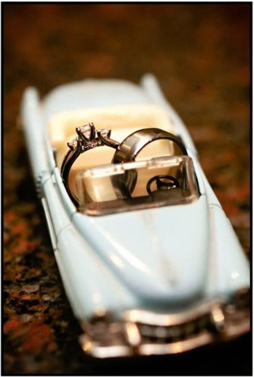 Cute picture of his and her wedding ring / couple ring on a car seat
